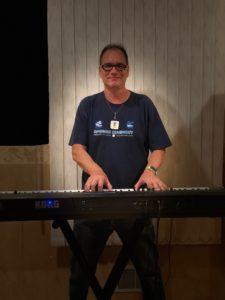Greg Berger senior music instructor performing